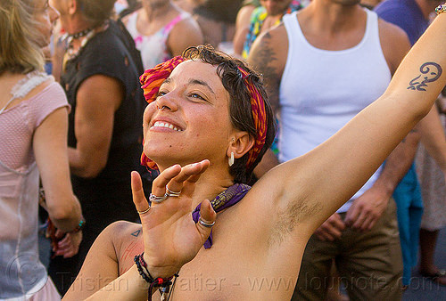 yassmine dancing at decompression 2014 (san francisco), arm tattoo, bandana, bracelets, burning man decompression, dancing, finger rings, headband, hippie, jewelry, necklaces, nose piercing, septum piercing, woman, yassmine