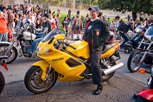 yellow ducati ST4 motorcycle, dolores park, ducati, dykes on bikes, gay pride festival, motorbike, motorcycle, parade, rider, riding, st4, woman, yellow