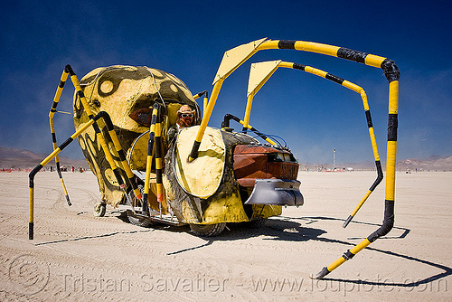 yellow spider, art car, burning man, legs, people