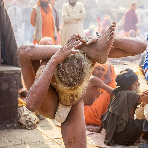 yogi sadhu in yoga position standing with leg behind the head (nepal), baba, beard, contortionist, hindu, hinduism, kathmandu, maha shivaratri, man, pashupatinath, sadhu, stretching, yoga, yogi
