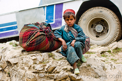 young boy - child labor - amarnath yatra (pilgrimage) - kashmir, bag, bearer, child labour, kid, mountain trail, mountains, people, pilgrim, porter, road, tire, trekking, wallah, wheel, yatris, अमरनाथ गुफा