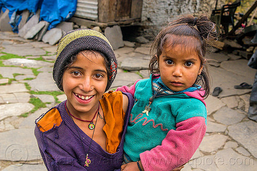 young girl holding her little sister in himalayan village (india), children, girls, holding, janki chatti, kids, knit cap, little girl, necklaces, people, siblings, sisters