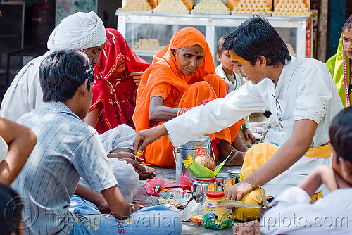 young guru (hindu holy man) performing ceremony - orchha (india), baba, bhagwa, ceremony, guru, hindu holy man, hinduism, india, men, orchha, ritual, saffron color, women