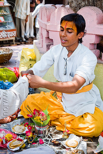 young guru (hindu holy man) performing sacrament ceremony - orchha (india), baba, ceremony, guru, hindu holy man, hinduism, india, men, orchha, ritual, tilak, women