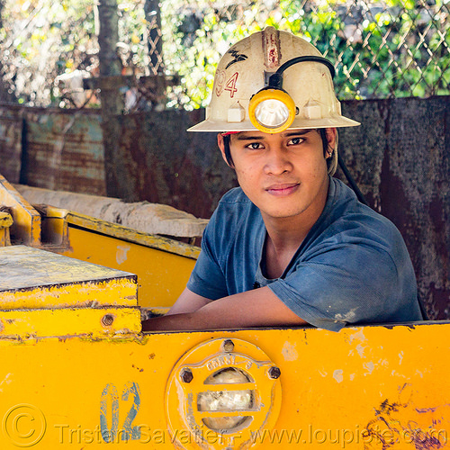 young miner in minecart (philippines), balatoc mines, gold mine, head light, helmet, mancart, men, mine railway, mine train, mine trolley, miners, philippines, workers