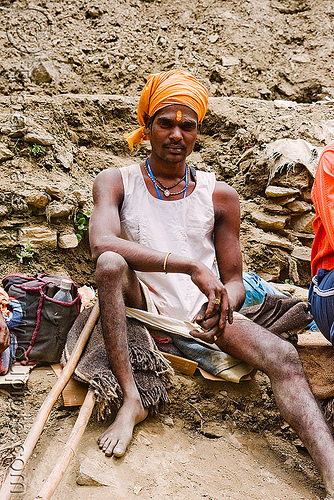 young sadhu (hindu holy man) resting on trail - amarnath yatra (pilgrimage) - kashmir, amarnath yatra, baba, hiking cane, hindu holy man, hinduism, kashmir, mountain trail, mountains, pilgrim, pilgrimage, resting, sadhu, trekking, walking stick, yatris, अमरनाथ गुफा