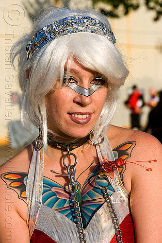 young woman with butterfly chest tattoo -, butterfly tattoo, chain, collar, islais creek promenade, makeup, silver wig, superhero street fair, tattooed, tattoos, white wig, woman