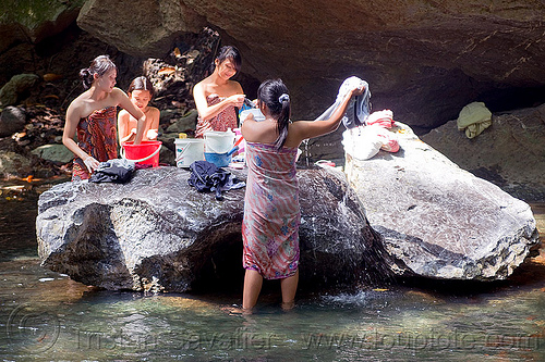 young women doing laundry in river, borneo, child, kid, laundry, little girl, malaysia, river, rock, wading, washing, women