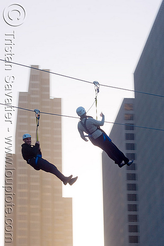 zip-line over san francisco, adventure, buildings, cable line, cables, climbing helmet, embarcadero, extreme sport, gear, hanging, harness, high-rise, justin herman plaza, mountaineering, moving fast, speed, steel cable, tower, trolley, two, tyrolienne, urban, zip line, zip wire, ziptrek