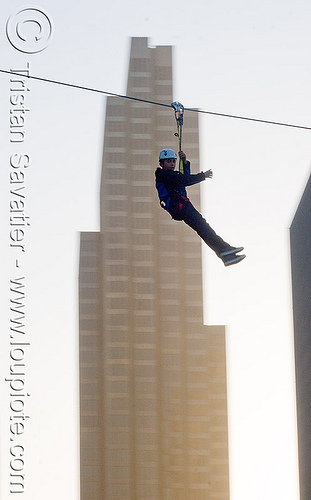 zip-line over san francisco, adventure, buildings, cable line, cables, climbing helmet, embarcadero, hanging, high-rise, mountaineering, moving fast, speed, steel cable, tower, trolley, tyrolienne, urban, zip line, zip wire