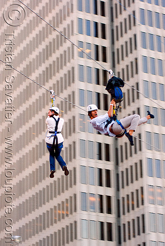 zip-line over san francisco, adventure, blue sky, buildings, cable line, cables, climbing helmet, embarcadero, hanging, high-rise, mountaineering, moving fast, speed, steel cable, tower, trolley, tyrolienne, urban, zip line, zip wire