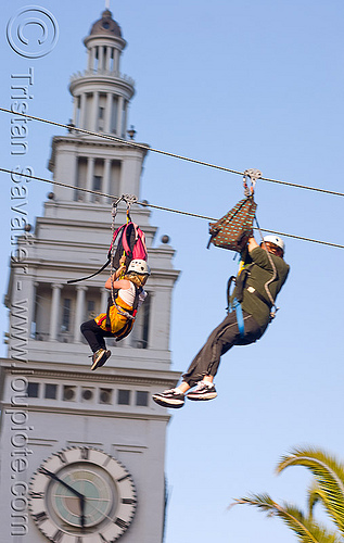 zip-line over san francisco, adventure, blue sky, cable line, cables, campanil, climbing helmet, clock, clock tower, embarcadero, embarcadero tower, extreme sport, fast, ferry building, gear, hanging, harness, justin herman plaza, mountaineering, moving, moving fast, people, speed, steel cable, trolley, two, tyrolienne, urban, zip line, zip wire, ziptrek