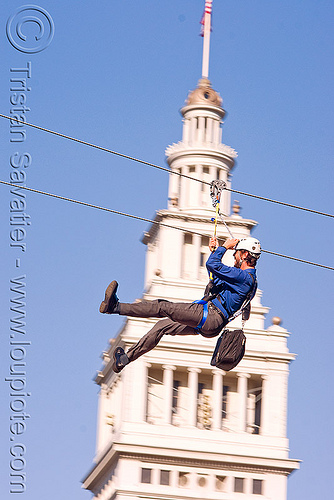 zip-line over san francisco, adventure, blue sky, cable line, cables, campanil, climbing helmet, clock tower, embarcadero tower, extreme sport, ferry building, gear, hanging, harness, justin herman plaza, mountaineering, moving fast, people, speed, steel cable, trolley, tyrolienne, urban, zip line, zip wire, ziptrek