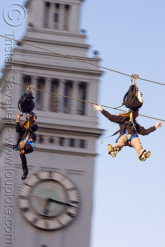 zip-line over san francisco, adventure, blue sky, cable line, cables, campanil, climbing helmet, clock tower, embarcadero tower, extreme sport, ferry building, gear, hanging, harness, justin herman plaza, mountaineering, moving fast, people, speed, steel cable, trolley, two, tyrolienne, urban, zip line, zip wire, ziptrek