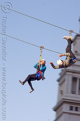 zip-line over san francisco, adventure, blue sky, cable line, cables, campanil, climbing helmet, clock tower, embarcadero tower, extreme sport, ferry building, gear, hanging, harness, justin herman plaza, mountaineering, moving fast, speed, steel cable, trolley, two, tyrolienne, upside-down, urban, zip line, zip wire, ziptrek