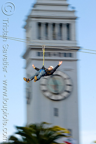 zip-line over san francisco, adventure, blue sky, cable line, cables, campanil, climbing helmet, clock tower, embarcadero tower, ferry building, hanging, mountaineering, moving fast, palm trees, speed, steel cable, trolley, tyrolienne, urban, zip line, zip wire