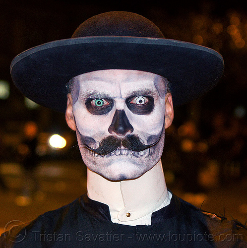 zombie priest with scary eyes, black hat, blue contact lenses, blue lenses, cappello romano, cassock, clergy, clerical collar, color contact lenses, day of the dead, dia de los muertos, face painting, facepaint, halloween, man, moustaches, mustache, night, pastor, priest, randal smith, saturno hat, skull makeup, special effects contact lenses, theatrical contact lenses, white contact lenses, white contacts, zombie
