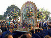 painting of virgin mary and jesus infant in catholic procession (san francisco), crowd, float, lord of miracles, parade, paso de cristo, peruvians, portador, portadores, procesión, procession, religion, sacred art, señor de los milagros, street