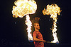 mushroom flames, fire dancer, fire dancing, fire performer, fire spinning, fire staff, man, mohawk hair, mushroom flames, night, spinning fire