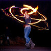 gina spinning a fire hula hoop (san francisco), fire dancer, fire dancing, fire hula hoop, fire performer, fire spinning, flames, hula hooping, long exposure, night, spinning fire