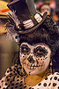 woman with cocktail hat and sugar skull makeup, bindis, black, cocktail hat, day of the dead, dia de los muertos, face painting, facepaint, feathers, halloween, night, polka dots, skull makeup, white, woman
