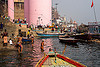 hindu holy bath in the ganges river - ghats of varanasi (india), ganga river, ganges river, ghats, hindu, hinduism, holy bath, holy dip, mooring, pink tower, river bath, river bathing, river boats, varanasi, water tower