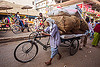 man pushing freight tricycle with heavy load (india), bags, bare foot, bearer, cargo tricycle, cargo trike, freight tricycle, freight trike, heavy, load, man, moving, pushing, sacks, street, transport, transportation, transporting, varanasi, walking