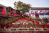 steps on the ghats of varanasi (india), buildings, ghats, houses, pink flags, stairs, steps, tree, vanishing point, varanasi
