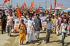 hindu procession at kumbh mela (india), banner, crowd, guru, hindu, hinduism, kumbha mela, maha kumbh mela, orange flags, procession, street, walking