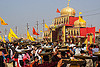 clay shiva lingam's ceremony and procession - kumbh mela (india), ashram, carrying on the head, clay, crowd, gate, hindu ceremony, hinduism, kumbha mela, lingams, lingas, maha kumbh mela, offerings, procession, shiva, street, trays, walking, yellow flags