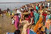 hindu devotees bring clay shiva linga's offerings to the ganges river (india), carrying on the head, clay, crowd, ganga river, ganges river, hindu ceremony, hinduism, kumbha mela, lingams, lingas, maha kumbh mela, offerings, procession, river bank, shiva, trays, walking, water