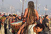 baba with long dreadlocks playing ritual drum on horse at kumbh mela (india), ceremony, crowd, dreads, drums, hindu, hinduism, horse riding, horseback riding, kumbh maha snan, kumbha mela, maha kumbh mela, mauni amavasya, men, naga babas, naga sadhus, naked, procession