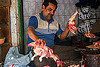 butcher dismembering a chichen, bird, blood, bloody, butcher, chicken, delhi, dismembering, halal, man, meat market, meat shop, meat shot, poultry, raw meat, skinning