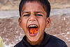 little boy's mouth full of carrots (india), boy, carrots, chewing, child, eating, kid, mouth, varanasi
