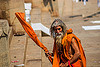 old hindu man in saffron color cloth on the ghats of varanasi (india), baba, beard, bhagwa, dreads, ghats, hindu, hinduism, old man, pilgrim, sadhu, saffron color, staff, varanasi
