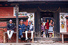 house with three men and three girls - patan (nepal), bench, door, girls, house, men, patan, sitting, street