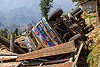 overturned truck crashed on house roof (nepal), corrugated metal, crash, ditch, lorry, mountain road, overturned, rollover, tata motors, traffic accident, truck accident, up-side-down, wreck