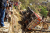 nepali villagers looking at overturned truck off mountain road (nepal), crash, ditch, lorry, mountain road, overturned, rollover, tata motors, traffic accident, truck accident, underbelly, up-side-down, wreck