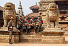 stone lions and nepali army soldiers on steps - bhaktapur durbar square (nepal), bhaktapur, durbar square, fatigues, gorkhas, guards, gurkha army, gurkha regiment, gurkhas, hat, hindu temple, hinduism, men, military, nepalese army, red stripe, sculptures, soldiers, stairs, statue, steps, stone lions, uniform