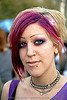purple hair and eye makeup, festival, love fest, lovevolution, lux, necklaces, nose piercing, pink, shaved eyebrows, woman