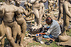 sculptor making clay sculptures on road side (india), bucket, clay, man, sculptor, sculptures, statues, west bengal, working