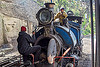 workers inspecting the boiler of a steam locomotive - darjeeling (india), 791, boiler, darjeeling himalayan railway, darjeeling toy train, fixing, men, narrow gauge, railroad, repairing, steam engine, steam locomotive, steam train engine, train depot, train yard, workers
