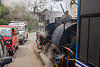 steam train sharing the road with cars - darjeeling (india), 788 tusker, cars, darjeeling himalayan railway, darjeeling toy train, man, narrow gauge, operator, railroad, road, smoke, smoking, steam engine, steam locomotive, steam train engine, street, train car