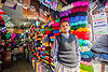 colorful cotton skeins in shop - darjeeling (india), darjeeling, man, merchant, rainbow colors, shop, skeins, standing, store, vendor, wool