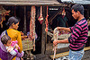 couple buying beef organs at meat market (india), baby, beef, child, couple, east khasi hills, kid, man, meat market, meat shop, meghalaya, organs, pynursla, raw meat, toddler, woman