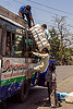 passenger loading luggage on indian bus - pushing large bundle over the head (india), bundle, bus, carrying on the head, freight, load, loading, luggage, men, passengers, public transportation