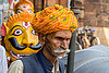mustachioed hindu pilgrim at the lingaraja temple - bhubaneswar (india), bhubaneswar, headdress, headwear, hindu temple, hinduism, lingaraj temple, lingaraja temple, man, moustaches, mustache, painted, pilgrim, sculpture, stone tiger, tilak, tilaka, turban, yellow