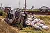 overturned truck with spilled cargo (india), 2515 cex, cargo, crash, freight, load, lorry, overturned, road, rollover, sacks, spilled, tata motors, traffic accident, truck accident, wreck