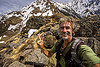 tristan savatier - mountain hiking in the indian himalayas near joshimath (india), hiking, man, mountains, peace sign, rocks, self-portrait, selfie, snow patches, stones, trekking, tristan savatier, v sign