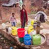 plastic water containers near hand pump (india), boy, child, hand pump, khoaja phool, kid, plastic jugs, village, water jugs, water pump, woman, खोअजा फूल